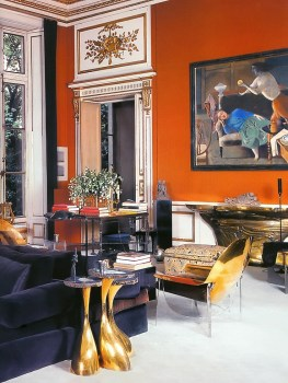 This vibrant Henri Samuel Parisian drawing room looks fresh and new with orange walls and contemporary furniture