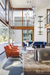 These orange chairs pop during summer and again come to life in Autumn in this contemporary home