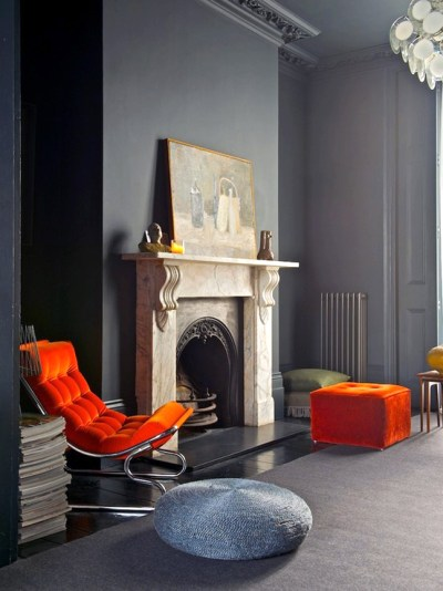 Using this bold orange luxurious fabric on the modernist chair and ottoman add great interest to the classic bones of this gracious room