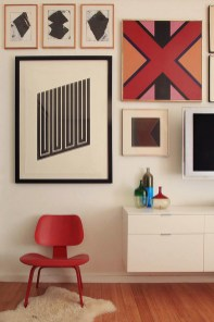 This beautiful gallery wall by Wyeth Alexander is perfectly whimsical and sophisticated with the Op Art piece and use of color on and off the wall.