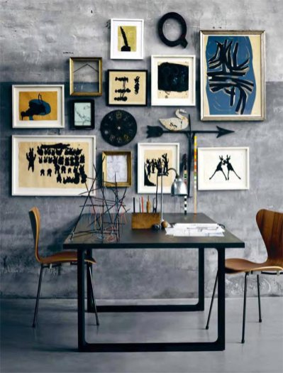 This wonderful collection of art creates a cohesive, a almost thematic gallery wall. The objects or accessories for table are also in perfect keeping for this masculine, sophisticated bohemian look.