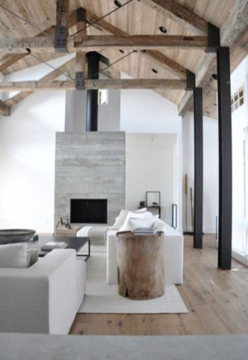 Adding a clean contemporary mantel and using white walls with light floors creates a light and airy feeling all year through in this barn conversion.