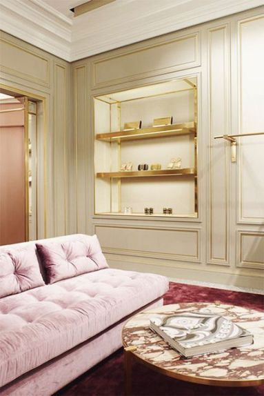Blush pink sofa with a rich jewel tone carpet, creamy pale celadon walls and gold trim. A very sophisticated palette in the Pucci Flagship on Madison Avenue in New York