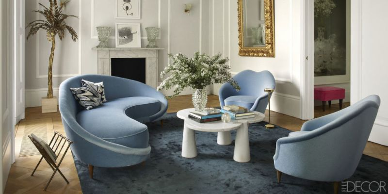 This fantastic flat in London is made sublime using the 'blue trick'. The chic blue rug and varying shades of blue with the silk rug and the mohair upholstery make for a cozy and chic room.