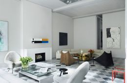 This chicly minimal SoHo loft unapologetically boasts two seating areas of complimentary, but not matching moods. Mixing cool and warm tones feels fresh and modern here. Mixing Cocktail Tables done right