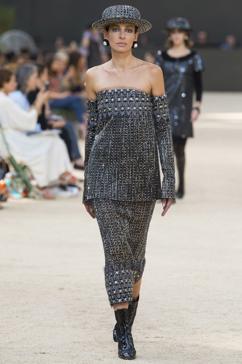 Model walking down runway at Chanel fall 2017 couture show in two piece set