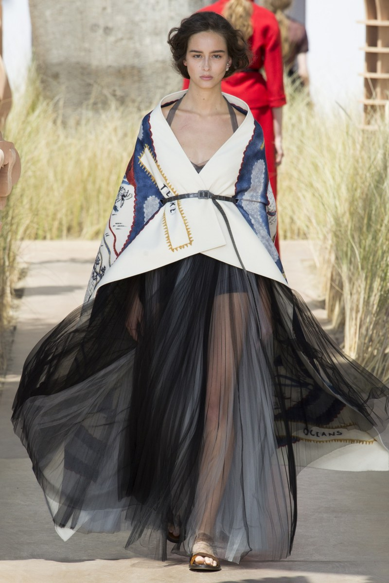 Model in dior dress walking down runway at fall 2017 couture show