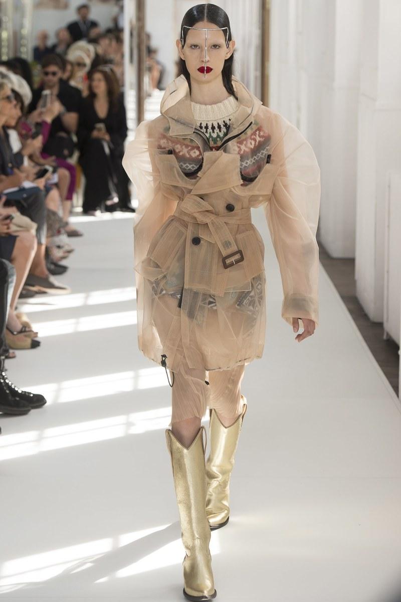Model walking down runway at margiela runway show in paris
