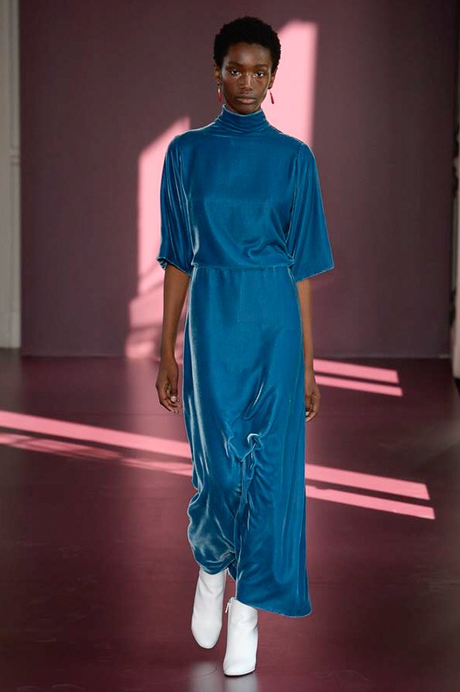 Model walking down runway in blue valentino dress