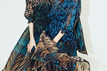 two models in alena akhmadullina feather print dresses in blue and green