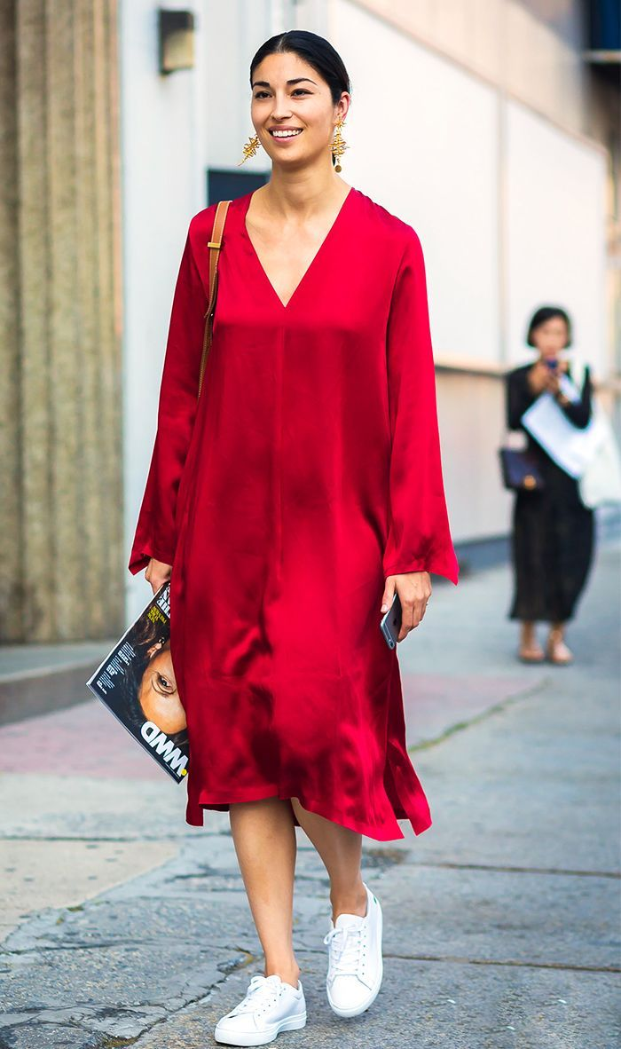 street style blogger in red silky dress and sneakers