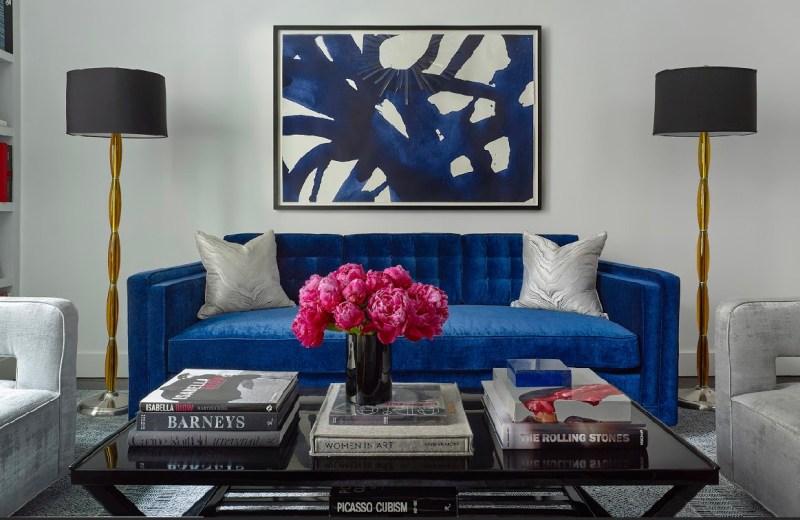 Cobalt sofa, pink peonies, coffee table, coffee table books