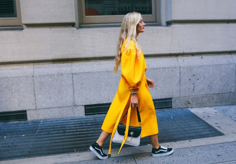 Street style blogger in yellow balloon sleeve dress and old school vans