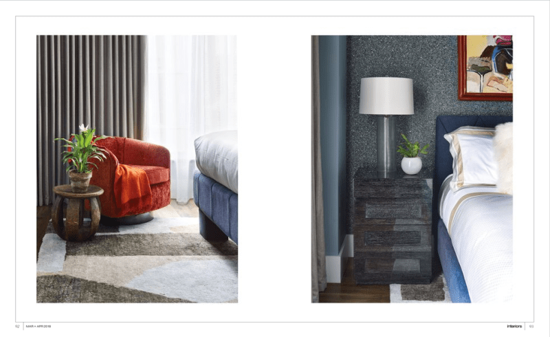 Image of interiors magazine spread featuring Joe Lupo VT Home. Two images feature a bedroom with geometric carpet, burnt orange velvet arm chair, african walnut side table, blue bed with headboard, blue graphite wall covering by romo, side dresser with lamp and round bowl.