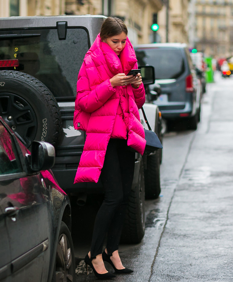 Street style shot of blogger wearing pink puffer coat and scarf