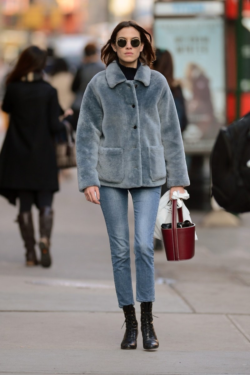 street style shot of Alexa Chung wearing blue fur jacket, jeans and carrying Staud bag spring trend 2018 IT bag