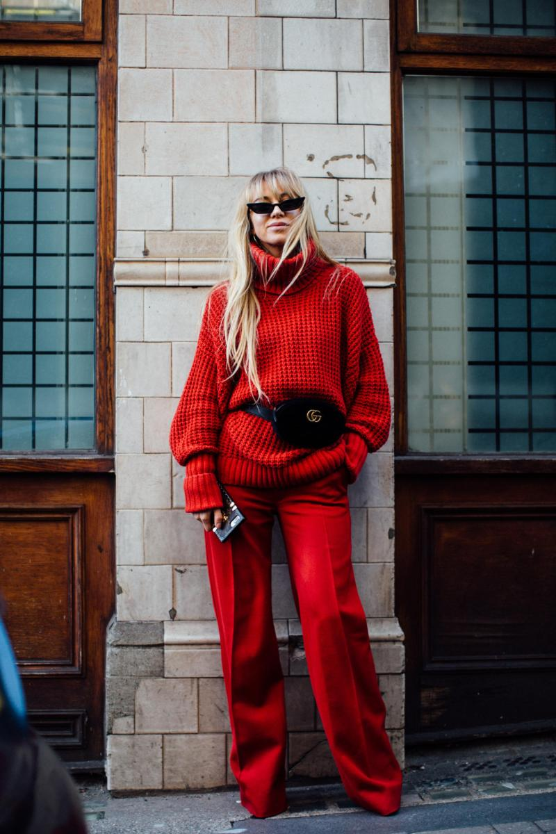Street style shot of blogger attending london fashion week in red monochromatic outfit pants and shirt