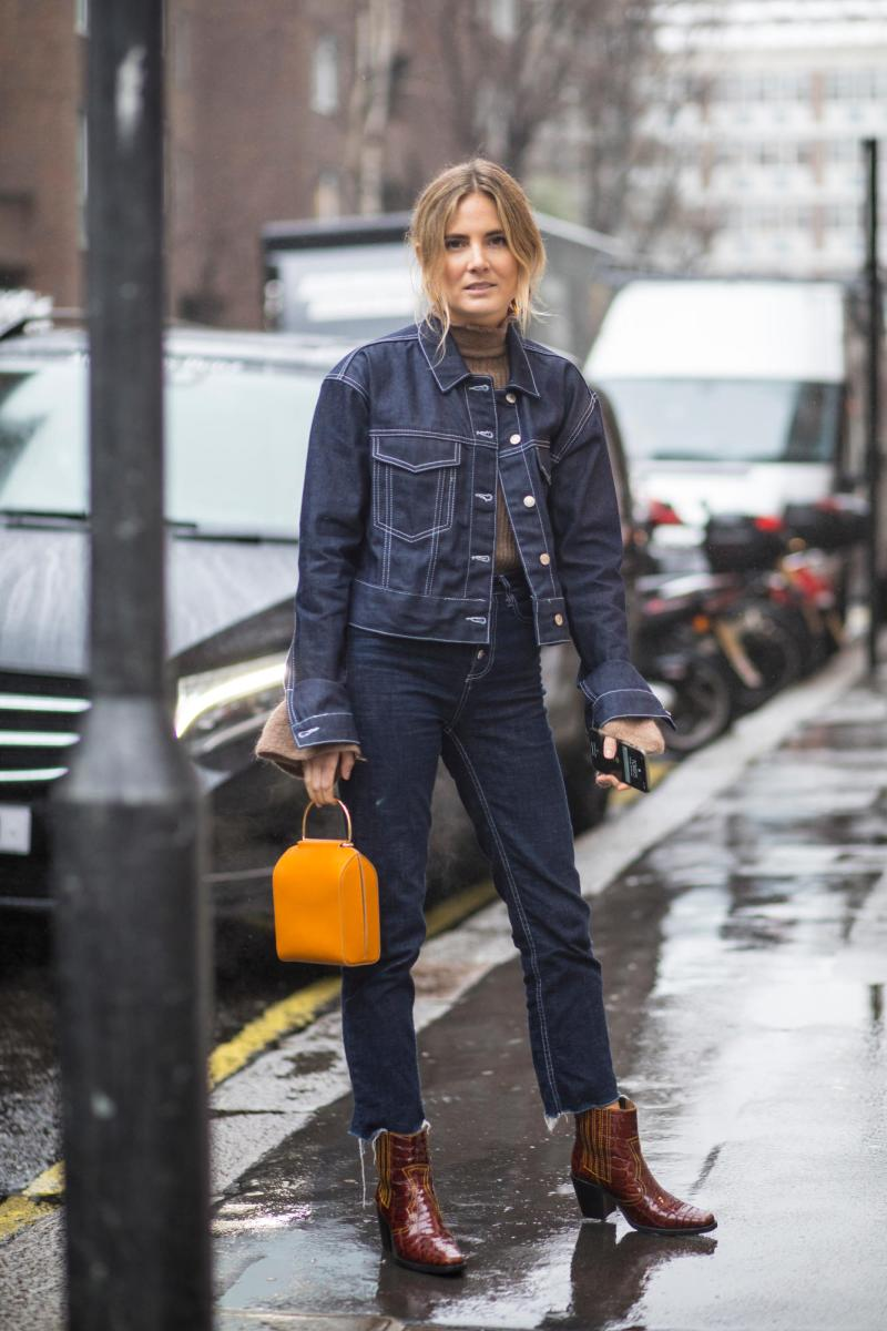 Street style shot of blogger wearing denim contrast stitching outfit