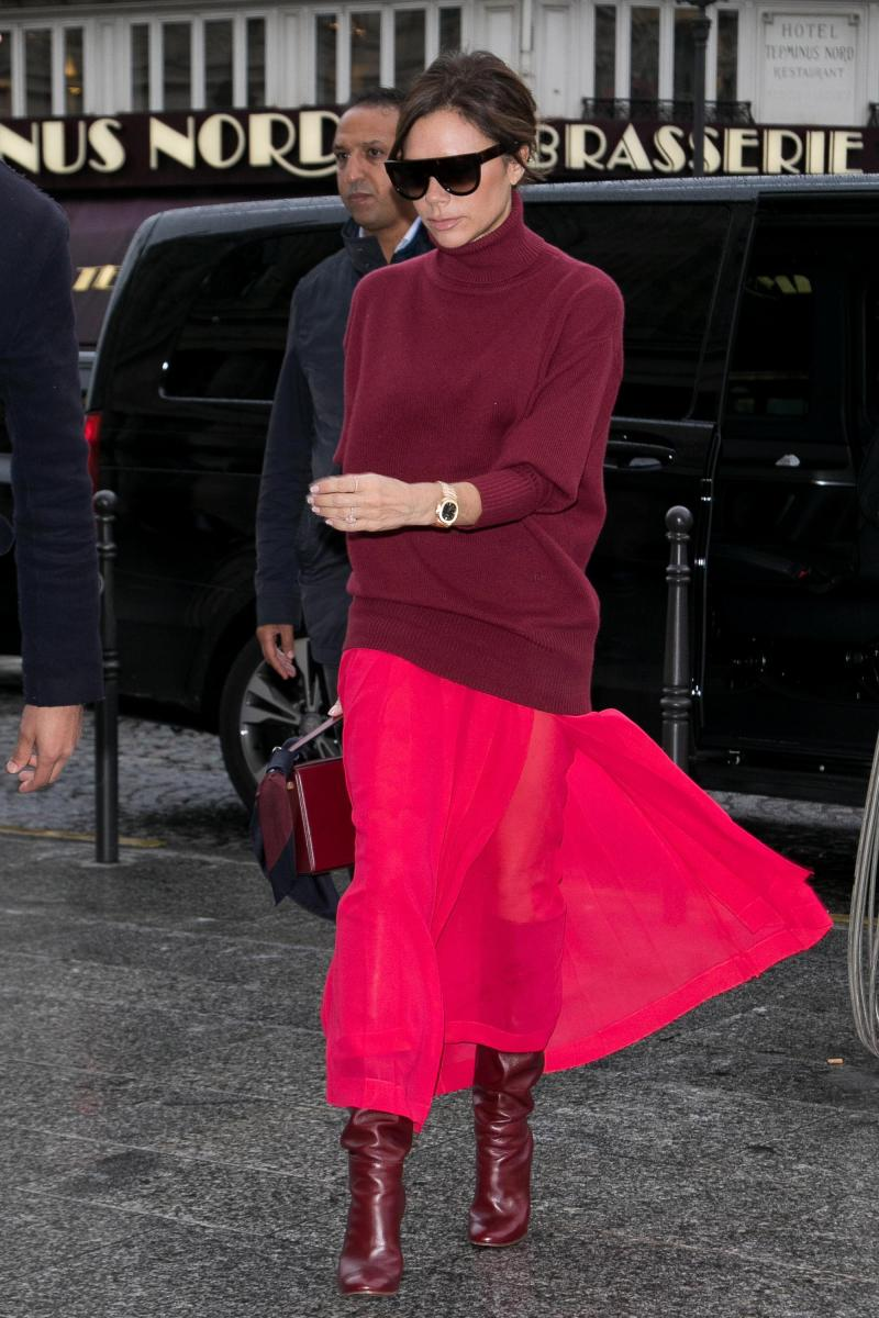 victoria beckham in a red sheer skirt and burgundy sweater