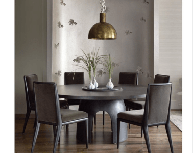 Photo of a dining room designed by nyc based interior designer Joe Lupo. It is a photo of wallpaper with hand painted koi fish from brunschwig fils, a brass chandelier, olive green pony hair chairs from profiles, a round dining table and three white onion vases.