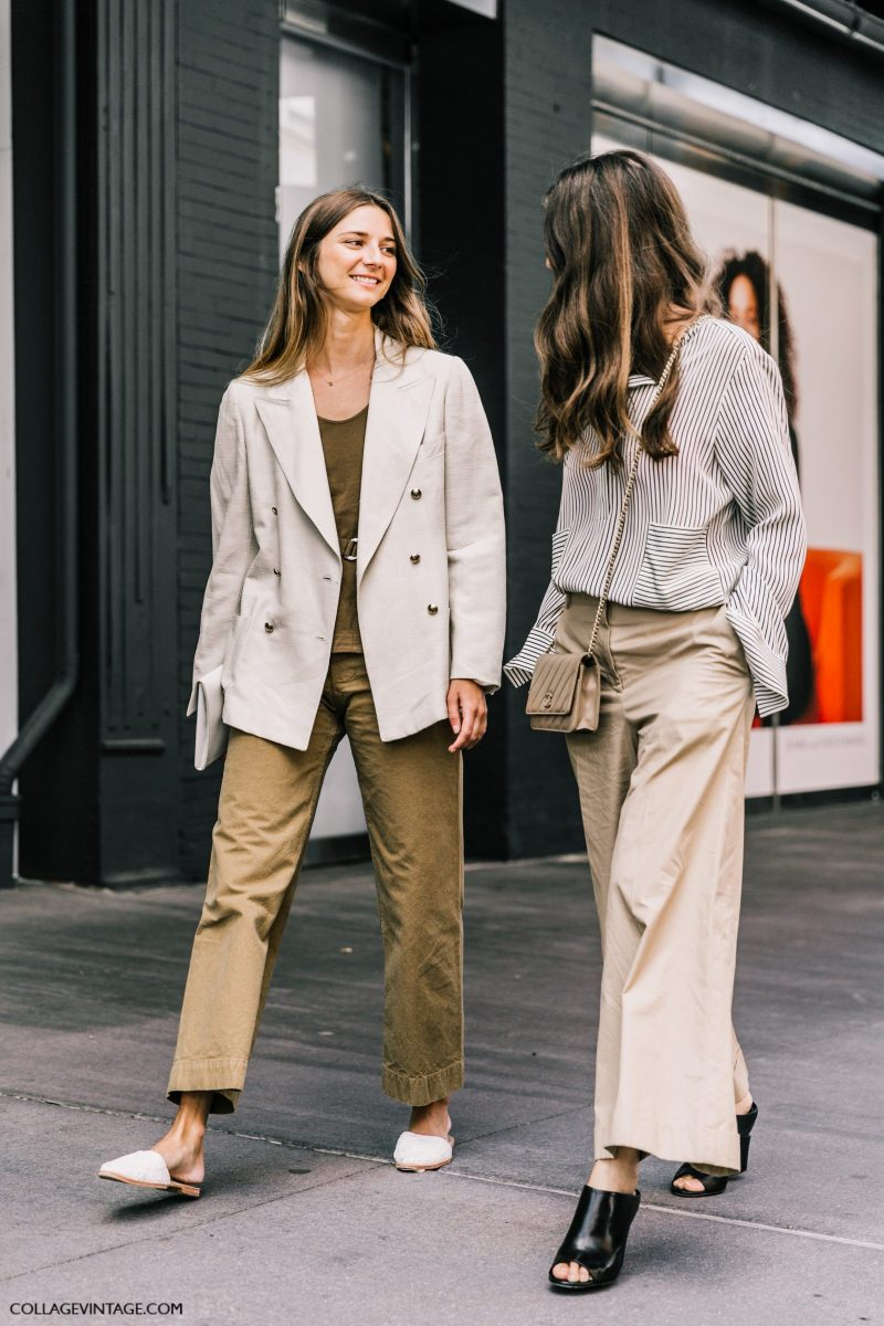 Street style shot of two girls attending new york fashion week wearing neutral outfits