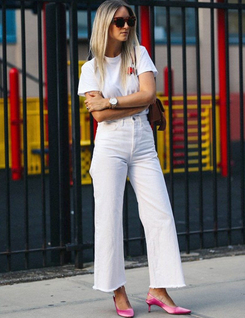 Street style shot of Fashion Guitar wearing all white outfit