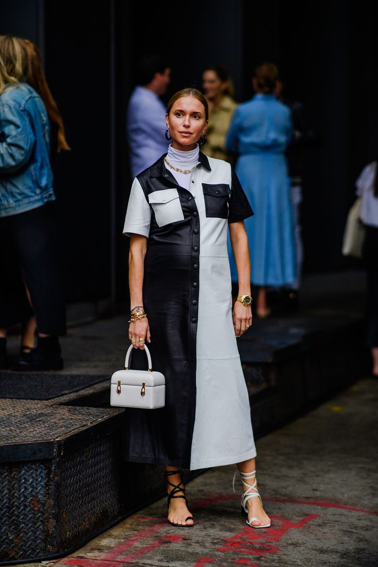 street style shot of pernille teisbaek at new york fashion week in celine black and white dress and black and white heels