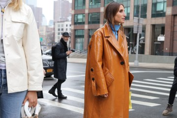 Street style shot of woman in patent tan trench coat jacket
