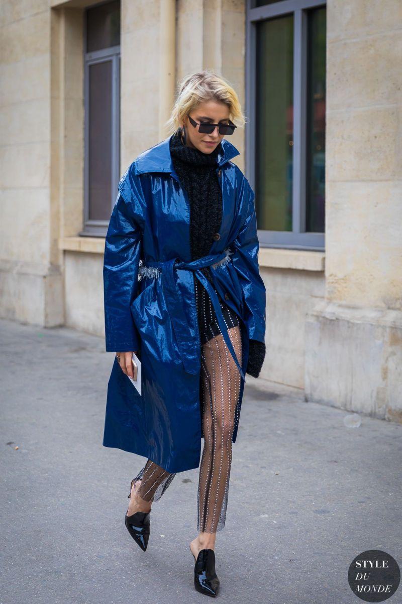 Street style shot of caroline daur in patent blue trench coat jacket