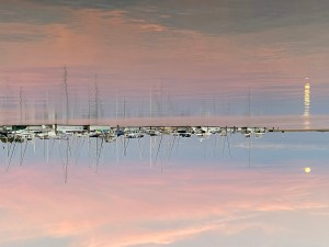 A moon reflected in a harbor upside down
