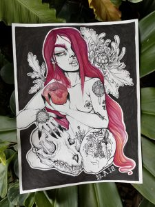 A drawing of a naked woman with red hair, holding a red orb and an animal skull