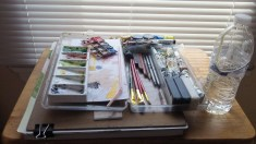 A portable watercolor kit keeps everything handy. Mine has a mixing tray, tubes of watercolor paints and some inks, drawing pencils, a few crayons and a pastel. Small pots let me mix large quantities of favorite washes and keep them.