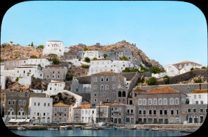 Hydra, Greece. On slide: town north of harbor from steamer