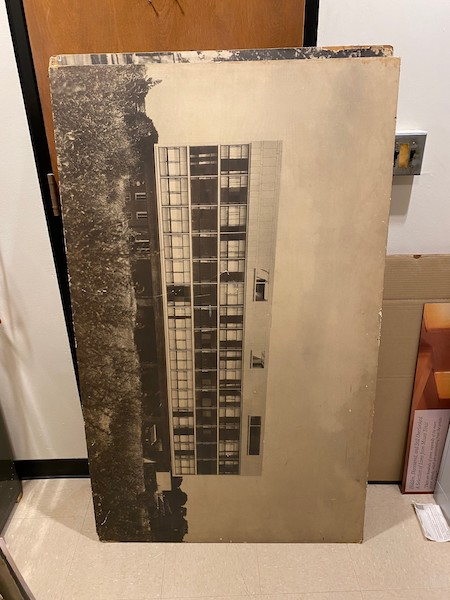 Large sepia-toned photograph mounted on board of a modern building