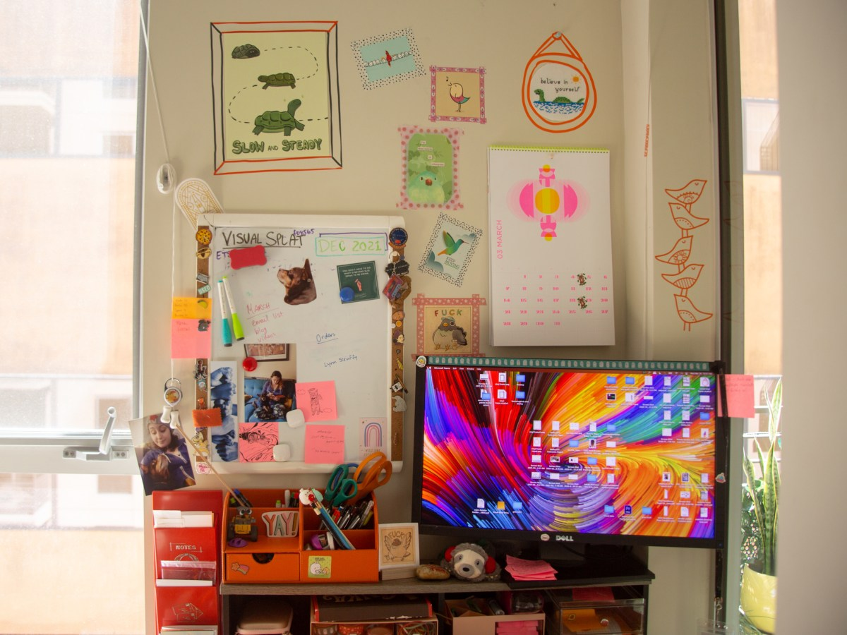 My newly-decorated home office area with my computer and wall decor