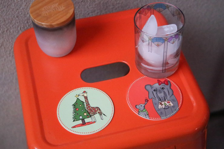Christmas Party Coasters featuring an illustrated giraffe and elephant