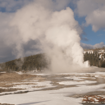 Old Faithful erupting, Yellowstone in Winter