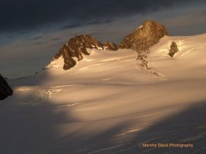 Tops of the New Zealand Alps poking out from the snow, photographed from a helicopter | Marsha J Black