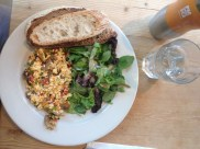 Tofu scramble, greens, and artisan bread at Le Pain Quotidien