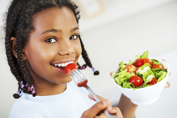 Little girl with healthy food. Eating salad and looking at camera. [url=http://www.istockphoto.com/search/lightbox/9786682][img]http://dl.dropbox.com/u/40117171/children5.jpg[/img][/url]
