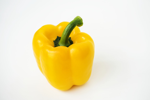 Macro shot of sweet bell pepper isolated on white background