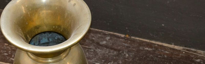 antique spittoon on floor