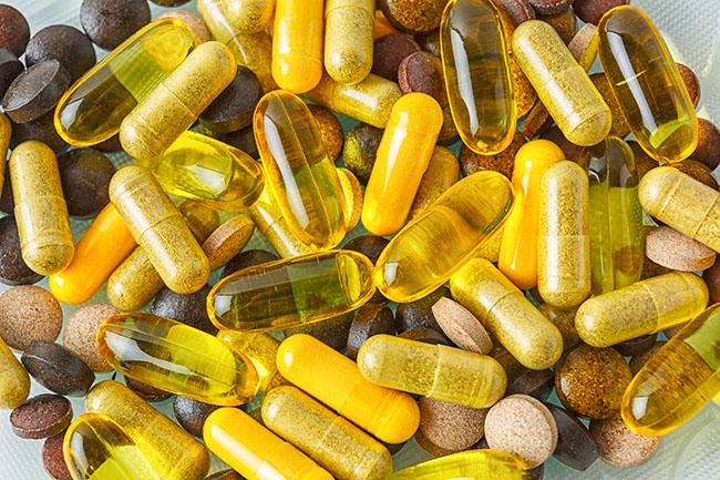 Ayurvedic pills as healthy lifestyle symbol. Vitamin capsule background