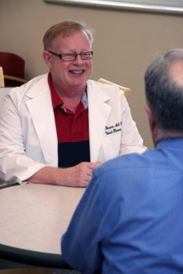 John Bowman, associate professor of pharmacy practice at the Texas A&M Health Science Center Irma Lerma Rangel College of Pharmacy, counsels a patient on how some medications react differently for the elderly.