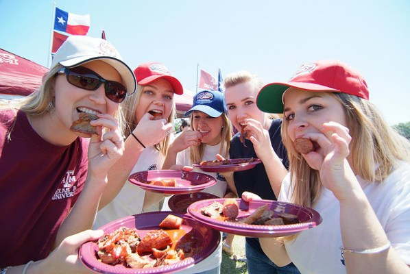 Photo of five girls tailgating at a Texas A&M football game.
