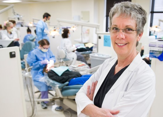 Laura Gene Utt, clinical assistant professor at TAMBCD's Caruth School of Dental Hygiene, pictured in the college's third-floor general dentistry clinic.