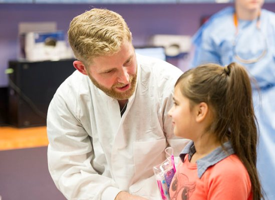 Pediatric Dentistry resident Ben Curtis, D.D.S., talks to his patient.