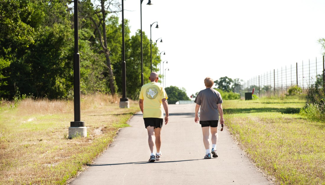 photo of couple on walking trail