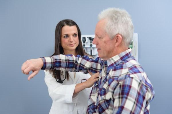 Doctor examining a senior patient.