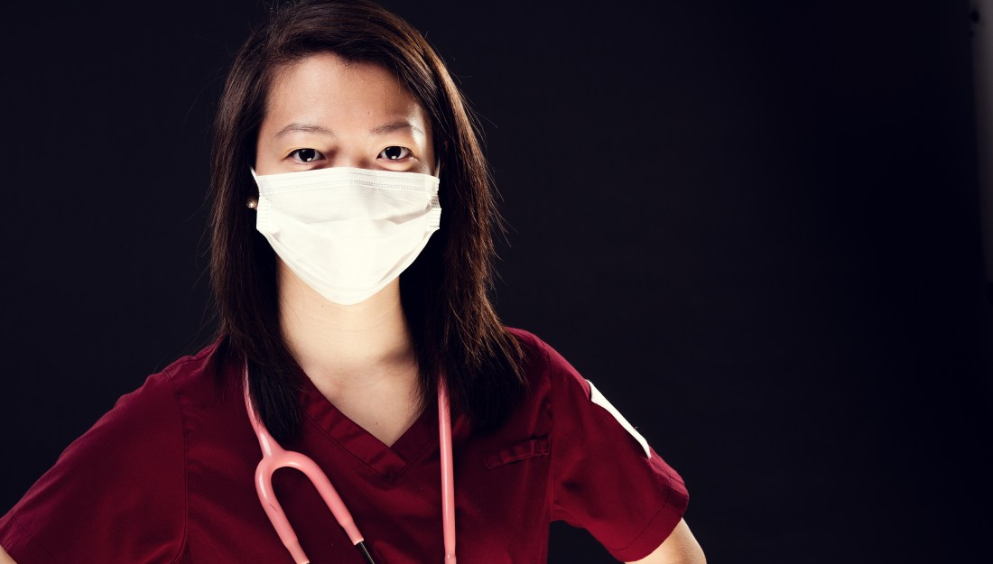 Health care professional in mask